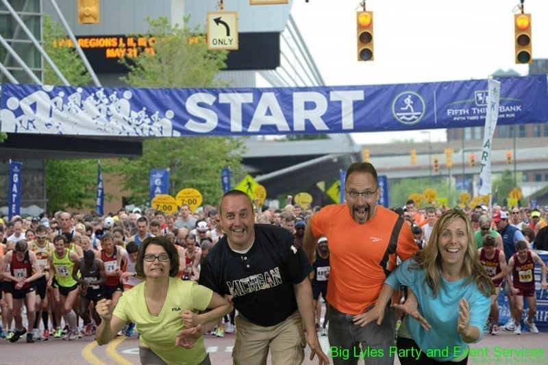 Two couples making funny faces and getting ready to run at 2014 Fifth Third River Bank Run in Grand Rapids MI