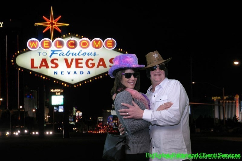 couple by Vegas Sign