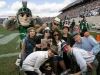 Kids on the field with Sparty